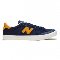 'New Balance Pro Court 212 Shoes - Navy/Poppy' from the web at 'https://cdn.ccs.com/media/catalog/product/cache/4/small_image/235x/9df78eab33525d08d6e5fb8d27136e95/1/9/191264829541-1.1509200652.jpg'